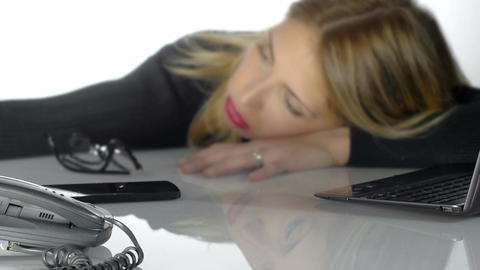 tired and depressed businesswoman at work lying with his head on the desk Footage