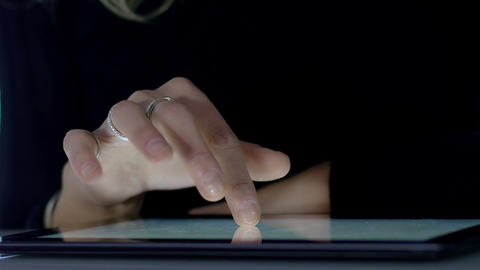 closeup footage on woman's hand over touch screen of a tablet ビデオ