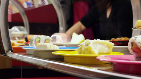 conveyor belt in a japanese reasturant with traditional dishes Footage
