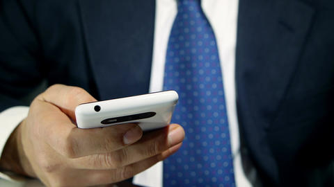 elegant businessman with tie using smartphone Footage