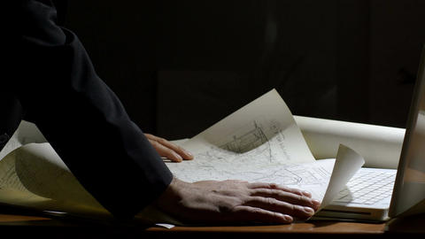 architect working on a map in his office Footage