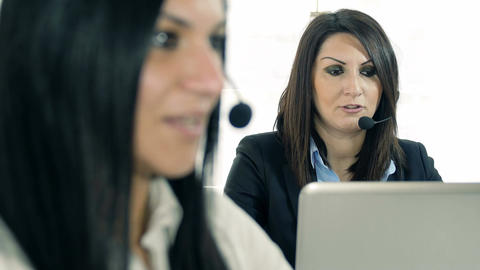 customer care center: businesswomen at work with headset Footage
