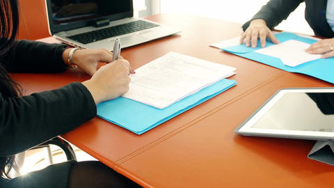 documents sign: two businesswomen at work in office Footage