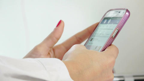 businesswoman using a modern mobile phone: closeup footage on hands Footage