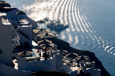 Backlit Houses on Santorini Caldera and Parked Yachts Fotografía