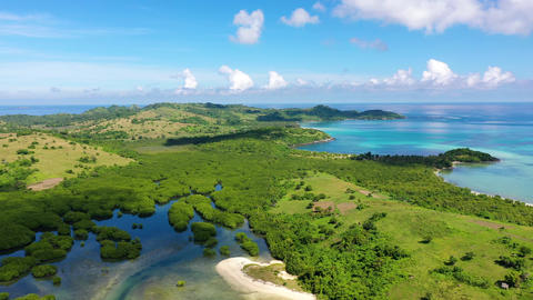 A tropical island with a turquoise lagoon and a sandbank. Caramoan Islands Live Action