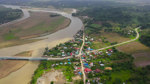 Landscape, bridge over the river and town, top view. River Town on Luzon Island Live Action