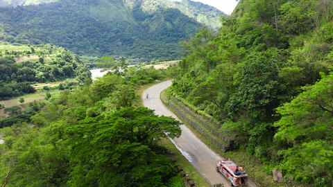 Philippines mountain landscape. Winding rainforest road in Cordillera mountains Live Action
