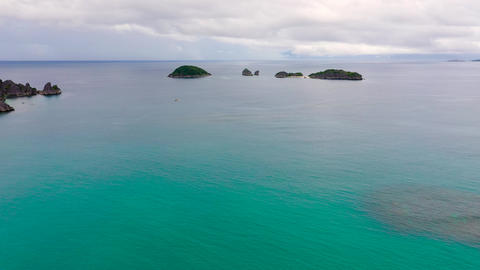 Tropical islands and blue sea, aerial drone . Caramoan Islands, Philippines Live Action