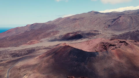 Amazing aerial view of a volcanic crater in El Hierro island, Canary Islands Live Action