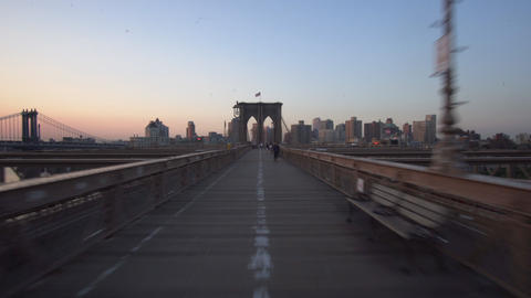 Hyper Lapse over Empty Brooklyn Bridge at Sunrise with few people in times of Live Action