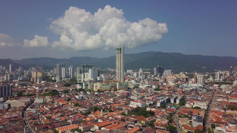 Aerial view KOMTAR building with old colonial building Live Action