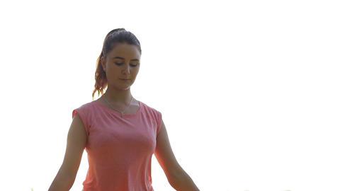 Meditation in lotus yoga pose. Woman training yoga 실사 촬영
