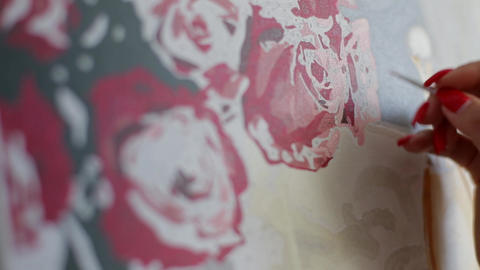 Girl paints a picture with acrylic paints on canvas, hobby painting Live Action