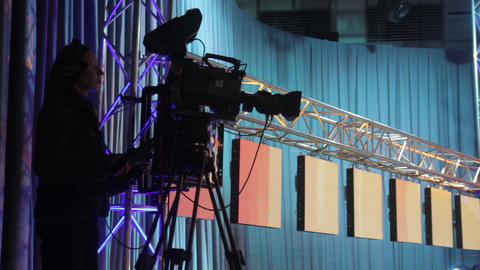 Cameraman with a camera in a TV studio while recording TV broadcasts Live Action