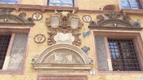 Architecture detail of buildings in Piazza dei Signori in Verona Live Action