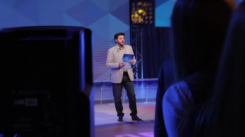 Male man TV presenter in a TV studio. TV presenter. TV host Live Action