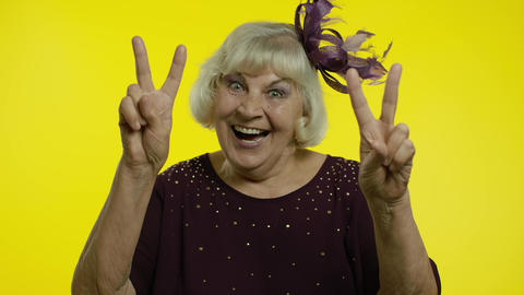 V sign, peace. Happy senior old woman showing victory sign with double fingers Live Action