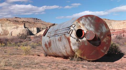 Medium-shot of a fallen water tower lying in the desert Stock Video Footage