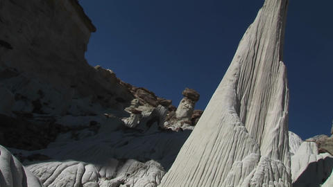 Pan-up from the crevice of a white limestone canyon walls... Stock Video Footage
