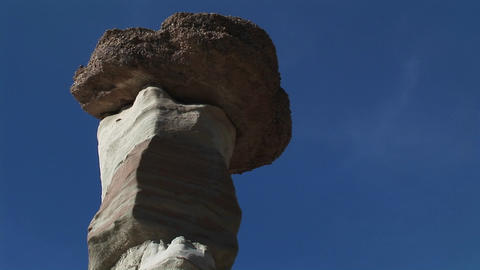 Close-up of a rock sitting on top of a limestone pillar Footage