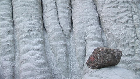 Medium-shot of a granite rock sitting at the base of a... Stock Video Footage