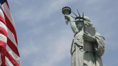 Time lapse of clouds behind the Statue Of Liberty in this shot which says patriotism and patriotic v Footage