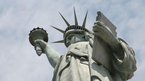 Time lapse tilt up of clouds behind the Statue Of Liberty... Stock Video Footage