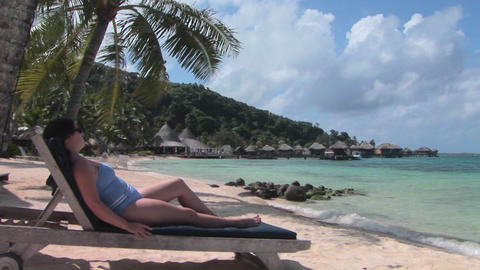 A woman relaxes on a beach chair Stock Video Footage