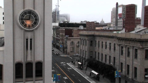 Time-lapse of a city street with a clock in the foreground Footage
