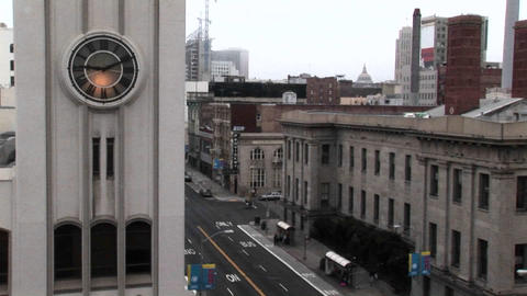 Time-lapse of a city street with a clock in the foreground Stock Video Footage