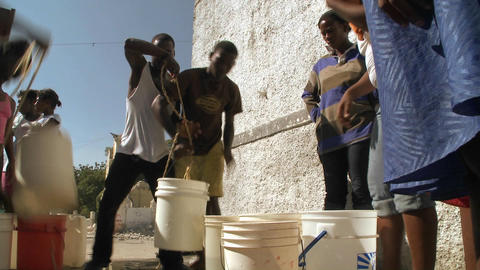 People get water from a well following a massive e Footage