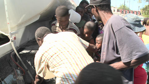 Earthquake refugees line up for supplies in Haiti Stock Video Footage