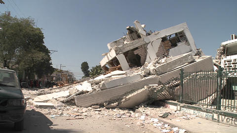 Pan to collapsed buildings following the Haiti ear Stock Video Footage