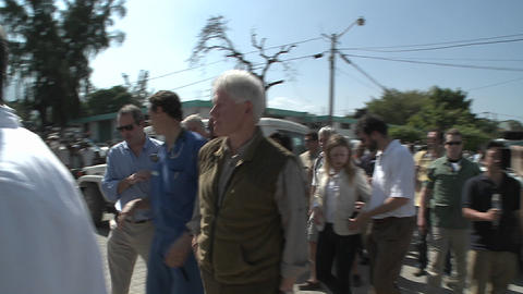 Bill and Chelsea Clinton visit refugees during the Footage
