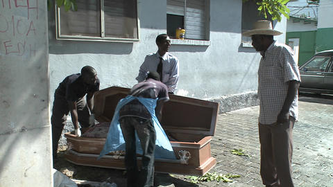 A victim of the Haiti earthquake is loaded into a Stock Video Footage