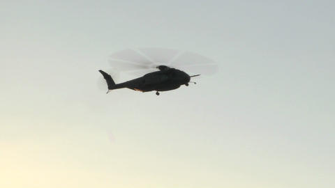 A Blackhawk helicopter hovers and prepares to land Stock Video Footage
