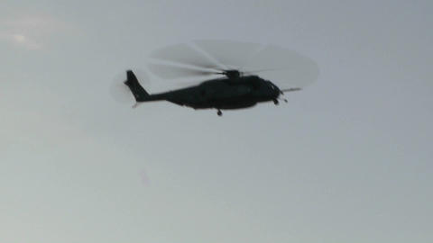 A Blackhawk helicopter hovers and prepares to land Footage