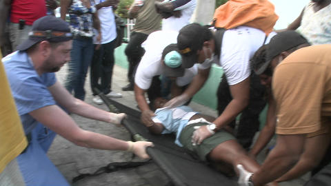 A victim is moved from a stretcher during the eart Stock Video Footage