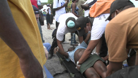 A victim is moved from a stretcher during the eart Live Action