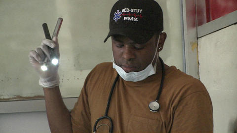 Doctors operate on injured victims of the Haiti ea Footage