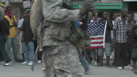 Victims hold up an American flag while armed soldi Stock Video Footage