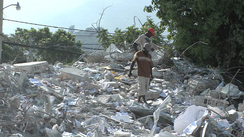 Workers search among piles of rubble after the Hai Stock Video Footage