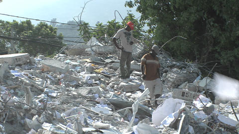Workers search among piles of rubble after the Hai Footage