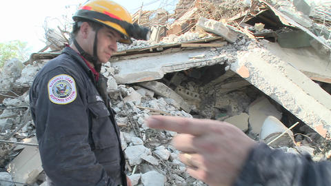 Rescue workers search among piles of rubble after  Footage