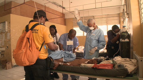 Doctors work in a trauma center following the Hait Footage