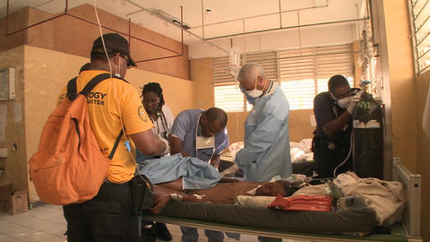 Doctors work in a trauma center following the Hait Stock Video Footage