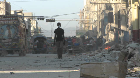 People walk through the destroyed streets of Haiti Stock Video Footage