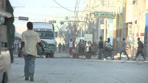 Chaos and damage on the streets of Port Au Prince Stock Video Footage