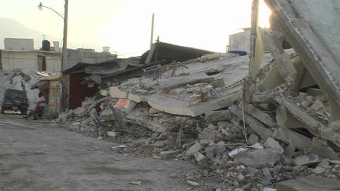 Piles of rubble line the streets following the dev Stock Video Footage